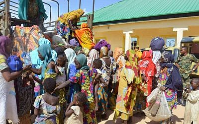In this Thursday, July. 31, 2015 file photo, women and children rescued by Nigerian soldiers from Boko Haram extremists in the northeast of Nigeria arrive at the military office in Maiduguri. (AP Photo/Jossy Ola file)