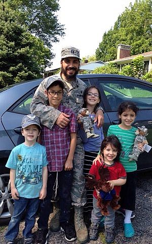 Chabad chaplain Rabbi Elie Estrin and his five children in Washington state. (courtesy)