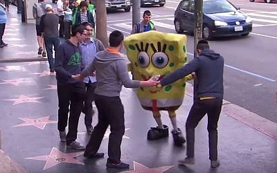 Jewish Yeshivah students unknowingly participate in a social experiment to help costumed actor who collapsed on Hollywood Boulevard on the Jimmy Kimmel show, August 25, 2015. (YouTube)