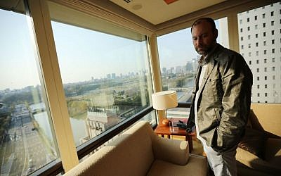 In this Tuesday, April 1, 2014, file photo, Noel Biderman, chief executive of Avid Life Media Inc., which operates AshleyMadison.com., poses by a hotel room window overlooking the Imperial Palace grounds during a photo session in Tokyo. (AP/Eugene Hoshiko, File)