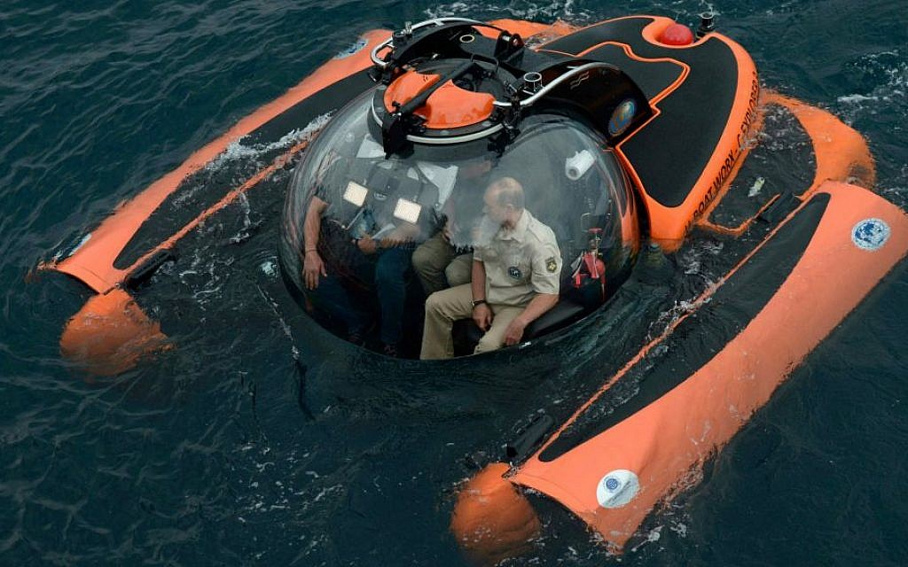 Russian President Vladimir Putin, right, sits on board a bathyscaphe as it plunges into the Black sea along the coast of Sevastopol, Crimea, August 18, 2015. (Alexei Nikolsky/RIA-Novosti, Kremlin Pool Photo via AP)