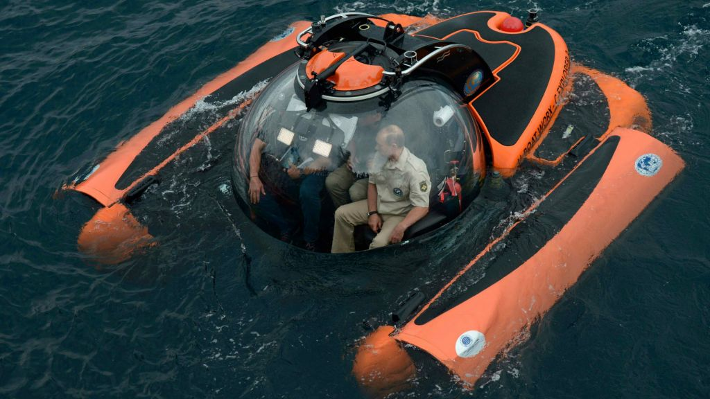 Russian President Vladimir Putin, right, sits on board a bathyscaphe as it plunges into the Black sea along the coast of Sevastopol, Crimea, August 18, 2015. (Alexei Nikolsky/RIA-Novosti, Kremlin Pool Photo via AP)