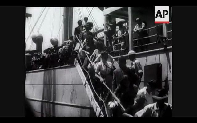 Jewish refugees from British detention camps in Cyprus file down the gangplank at the Haifa port (Screen capture: YouTube)