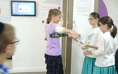 Children visit the Zomet Experience visitors center, a hands-on look at how electronics can be approved for Shabbat use. (Melanie Lidman/Times of Israel)