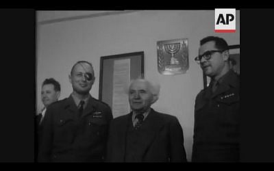 Chief of General Staff Moshe Dayan passes his title to Haim Lascov during a 1958 ceremony (Screenshot of newsreel footage from YouTube)