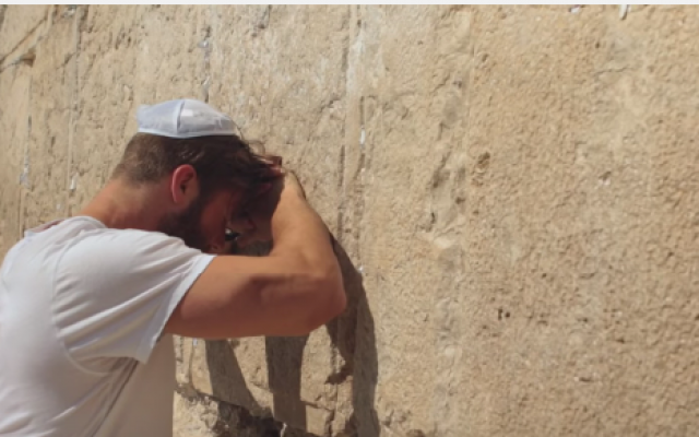 NFL star Julian Edelman praying at the Western Wall during a trip to Israel (screen capture via Youtube)
