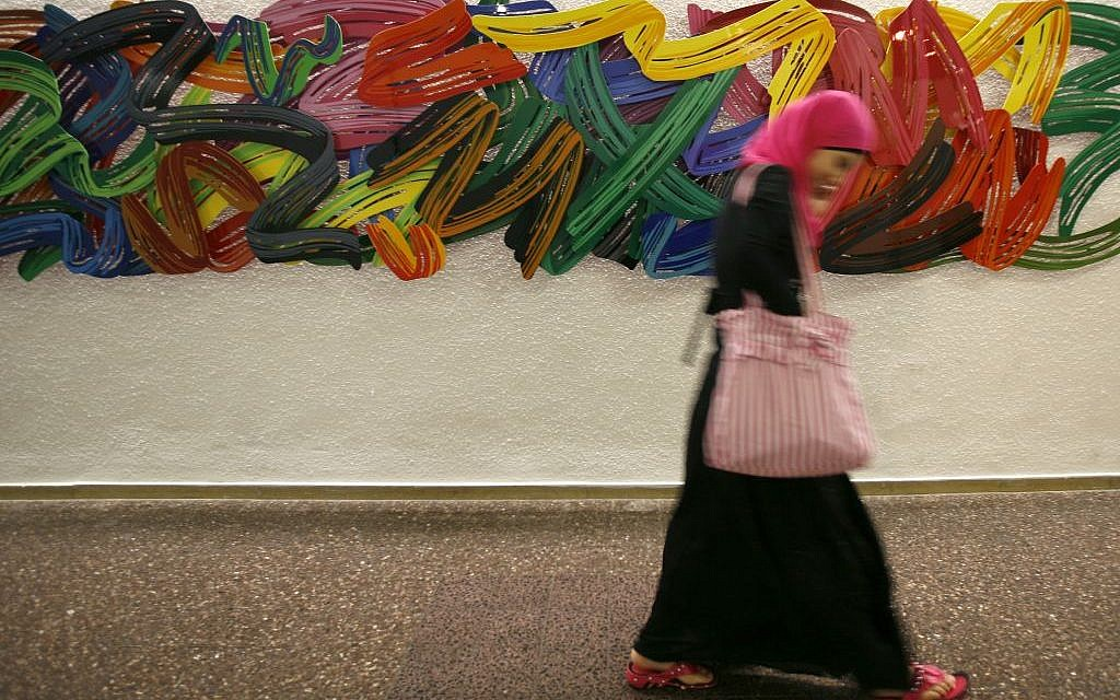 A female Arab student walks by colorful art hanging in the corridors of the Hebrew University campus in Jerusalem in 2009. (Miriam Alster/FLASH90)
