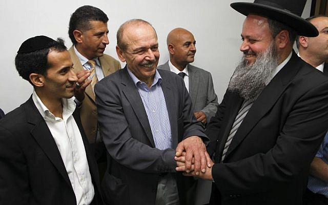 Israeli Likud and Shas party members meet with senior Palestinian officials Yasser Abed Rabbo and Nabil Shaath at the PLO offices in Ramallah, July 7, 2013 (Mati Milstein/Flash90)