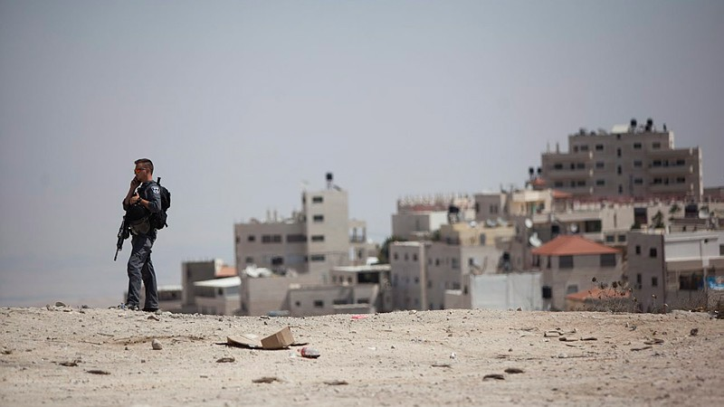 File: A police guard stands near the gas station in Jerusalem's French Hill, near the entrance to the village of Isawiyah neighborhood on September 9, 2014. (Yonatan Sindel/Flash90)