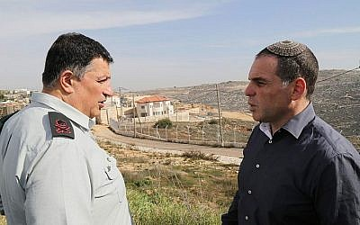 Government Coordinator in the Territories Brigadier general Yoav Mordechai (L) speaks with Oded Ravivi, head council of Efrat, during a tour expanding the settlement of Efrat in Gush Etzion on January 25, 2015. (Gershon Elinson/Flash90)
