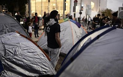 Israeli social activists protesting high housing costs near tents on Rothschild Boulevard in Tel Aviv on March 1, 2015. (Tomer Neuberg/Flash90)