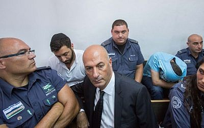 Gery Shalon, second left, and Ziv Orenstein, second right, suspected of being involved in several fraud schemes tied to the NYSE, seen in the Jerusalem Magistrates' Court, July 22, 2015. (Yonatan Sindel/Flash90)