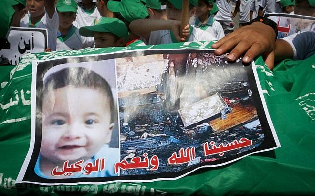 Palestinian children carry a funeral stretcher with a picture of 18-month-old Ali Saad Dawabsha, the toddler who was burned to death by suspected Jewish extremists, on August 1, 2015 in Khan Yunis, southern Gaza Strip, during a demonstration simulating a funeral ceremony and organized by Palestinian Islamist Hamas supporters in reaction to the death of the baby. (Abed Rahim Khatib/Flash 90)