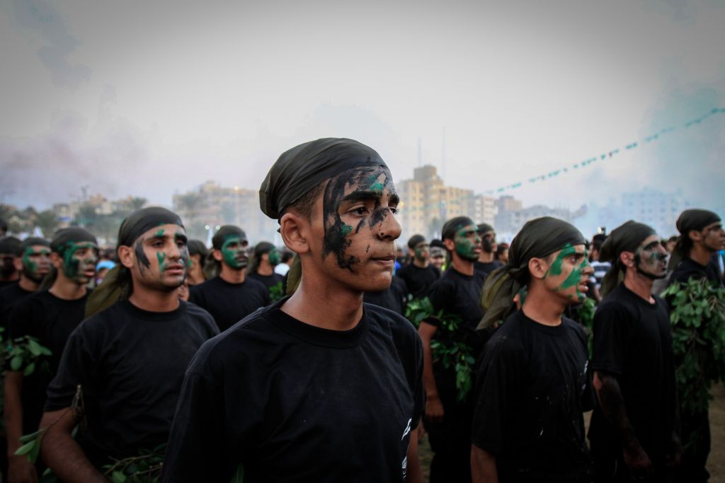 Palestinian youth demonstrate their skills during a graduation ceremony of a military-style camp organized by the Hamas movement, on August 5, 2015. (Aaed Tayeh/Flash90)