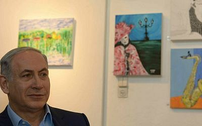 Prime Minister Benjamin Netanyahu visits an exhibition of paintings by the late Hadar Goldin, killed in battle in Gaza with his body never recovered, at the artists' village Ein Hod in northern Israel, on August 10, 2015. (Amos Ben Gershom/GPO)