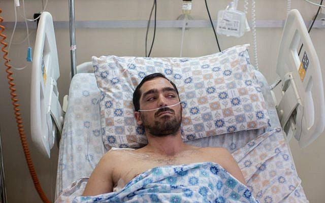 Stab victim Yehuda Ben Moyal at the Shaare Zedek Medical Center in Jerusalem on August 10, 2015 (Yonatan Sindel/Flash90)