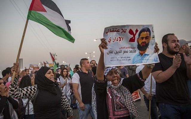 Demonstrators gather in support of Palestinian hunger-striker Mohammad Allaan, in front of the Barzilai Medical Center in the southern Israeli city of Ashkelon on August 16, 2015. (Hadas Parush)