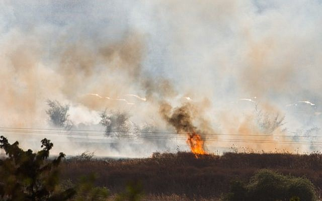 A large fire raging near Kfar Sold, caused by missiles fired from the Syrian side of the Israeli-Syrian border and hitting open areas in the Golan Heights in northern Israel on August 20, 2015. (Basel Awidat/Flash90)