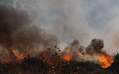 A large brush  fire raging outiside Kfar Sold in the Golan Heights sparked by four missiles fired from the Syrian side of the Israeli-Syrian border on August 20, 2015. (Basel Awidat/Flash90)