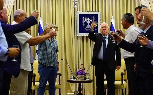 President Reuven Rivlin, center, meets with regional councils heads of West Bank settlements at the President's Residence, August 24, 2015. (Kobi Gideon/GPO)
