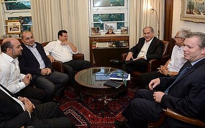 Prime Minister Benjamin Netanyahu meets with representatives of the Joint (Arab) List party to discuss enlarging the budgets for Arab towns in Israel, at the Prime Minister's office in Jerusalem, on Monday, August 31, 2015 (Amos Ben Gershom/GPO)
