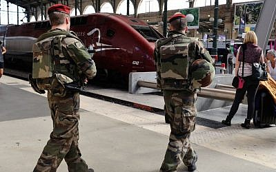 French soldiers patrol at Gare du Nord train station in Paris, France on August 21, 2015. (AP Photo/Binta, File)