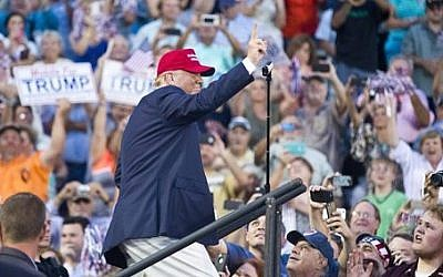 Republican presidential candidate Donald Trump waves to supporters during a campaign rally in Mobile, Alabama on Friday, August 21, 2015 (AP Photo/Brynn Anderson)
