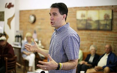 Republican presidential candidate Wisconsin Gov. Scott Walker speaks during a meet and greet with local residents in Greenfield, Iowa, August 27, 2015. (AP/Charlie Neibergall)