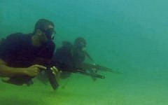 Hamas naval commandos, seen in a still image from a propaganda video released by the terror group during Israel's Operation Protective Edge, in the summer of 2014. (Screen capture)