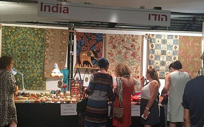Customers browse at the India booth in the International Pavilion at the 40th annual Hutzot Hayotzer fair from August 2-15, 2015 in Jerusalem. (Zahava Presser/The Times of Israel)