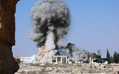 Smoke rises from the detonation of the 2,000-year-old temple of Baal Shamin in Syria's ancient city of Palmyra, August 25, 2015. (Islamic State social media account via AP, File)