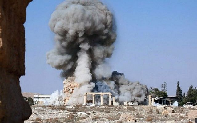 Smoke rises from the detonation of the 2,000-year-old temple of Baalshamin in Syria's ancient city of Palmyra, August 25, 2015. (Islamic State social media account via AP, File)