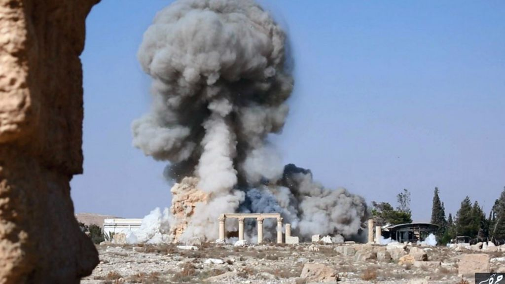 This undated file photo released Tuesday, Aug. 25, 2015 on a social media site used by Islamic State militants, which has been verified and is consistent with other AP reporting, shows smoke from the detonation of the 2,000-year-old temple of Baalshamin in Syria's ancient caravan city of Palmyra. (Islamic State social media account via AP, File)