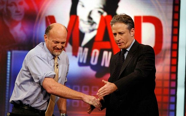 """In this March 12, 2009 file photo, Jim Cramer, left, host of the CNBC """"Mad Money"""" show, is welcomed by host Jon Stewart during an appearance on Comedy Central's """"The Daily Show with Jon Stewart"""" in New York. (AP Photo/Jason DeCrow, File)"""