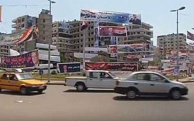 Traffic on a street in Latakia, Syria. (YouTube/Reuters)