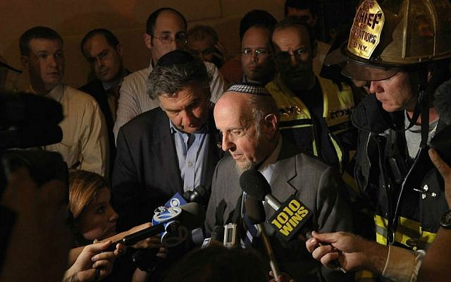 Rabbi Haskel Lookstein vowing to rebuild after a fire at Kehilath Jeshurun caused major damage to his New York synagogue, July 11, 2011.  (Michael Loccisano/Getty Images/via JTA)