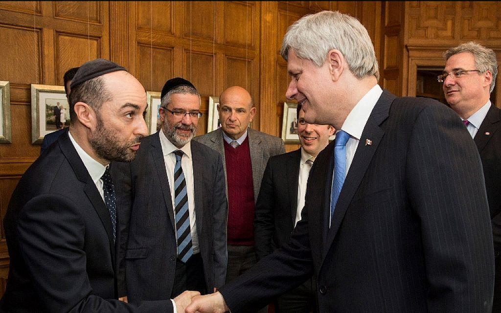 Steve Maman (left) shakes hands with Canadian Prime Minister Stephen Harper. (Courtesy Steve Maman)