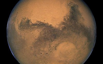The planet Mars, as seen by the Hubble Space Telescope in 2003  (NASA, ESA, and The Hubble Heritage Team / STScI/AURA)