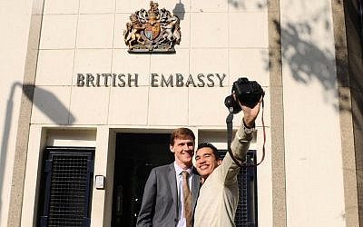 British Ambassador to Egypt, John Casson, poses for a selfie with an Egyptian photographer at the entrance to the British embassy in Cairo, Egypt, Dec. 16, 2014 (AP Photo/Mohammed Asad, File)