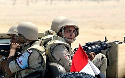 Egyptian army soldiers patrol the Cairo-Ismailia desert road in Egypt, Thursday, Aug. 6, 2015. (AP Photo/Amr Nabil)
