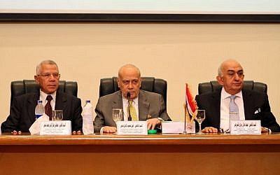 Ayman Abbas, center, head of the Supreme Election Committee, announces the dates for Egypt's parliamentary elections at a news conference in Cairo, Egypt, Sunday, Aug. 30, 2015. The committee announced that long-awaited parliamentary elections will take place in two stages in October and November. Egypt has been without a legislature for three years. In its absence, President Abdel-Fattah el-Sissi holds legislative authority. (AP/Ahmed Gamil)