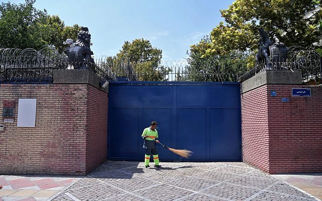 An Iranian street sweeper cleans in front of the British Embassy in Tehran, Iran, Saturday, August 22, 2015. (AP/Ebrahim Noroozi)