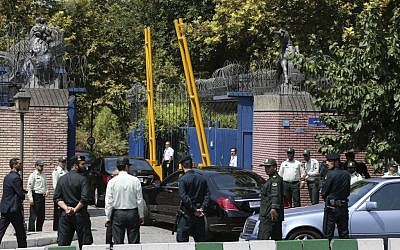 Escorted by Iranian police, a convoy carrying British Foreign Secretary Philip Hammond enters the British Embassy in Tehran, Iran, Sunday, Aug. 23, 2015. (AP Photo/Ebrahim Noroozi)