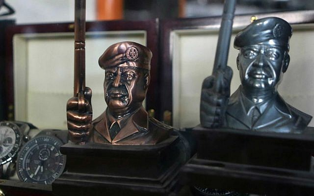 In this Aug. 4, 2015 photo, souvenirs of former Iraqi President Saddam Hussein are on display at a gift shop in Baghdad, Iraq. (AP Photo/Karim Kadim)