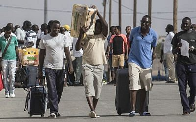 African migrants walk out of the Holot detention center in the Negev desert in southern Israel, Tuesday, Aug. 25, 2015. (AP Photo/Tsafrir Abayov)