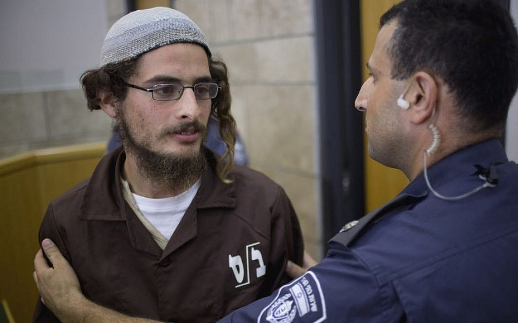 Alleged head of a Jewish extremist group Meir Ettinger appears in the Magistrate's Court in Nazareth Illit, August 4, 2015. (AP/Ariel Schalit)
