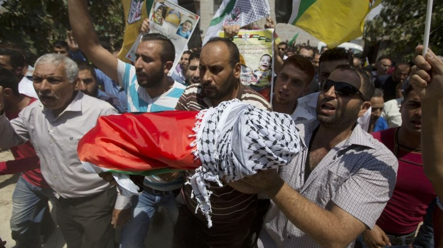 In this Friday, July 31, 2015 photo, Palestinians carry the body of one-and-a-half year old boy, Ali Dawabsha, during his funeral in Duma village near the West Bank city of Nablus. (AP Photo/Majdi Mohammed)