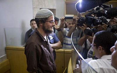 The alleged head of a Jewish extremist group, Meir Ettinger, appears in court in Upper Nazareth, Tuesday, Aug. 4, 2015. (AP Photo/Ariel Schalit)