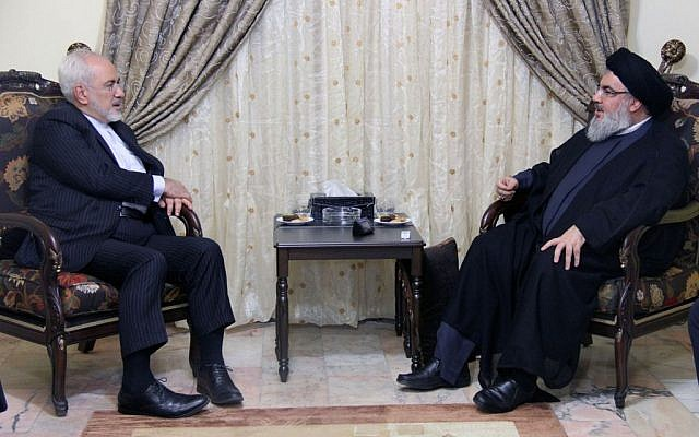 In this picture released by the Hezbollah media department, Hezbollah leader Hassan Nasrallah, right, meets with Iranian Foreign Minister Mohammad Javad Zarif, left, in Beirut, Lebanon, Wednesday, Aug. 12, 2015.  (Hezbollah Media Department via AP)