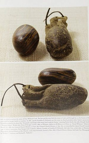 Pictures of smooth, brown, egg-sized rocks are shown in the printer's manuscript of the Book of Mormon at the Church of Jesus Christ of Latter-day Saints Church History Library, in Salt Lake City, August 4, 2015. (AP/Rick Bowmer)